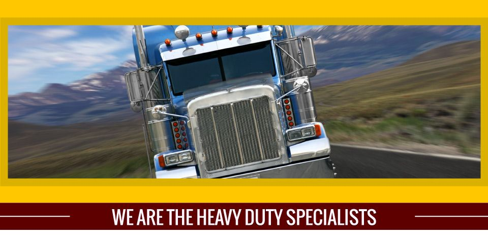 We Are the Heavy Duty Specialists | truck on the road